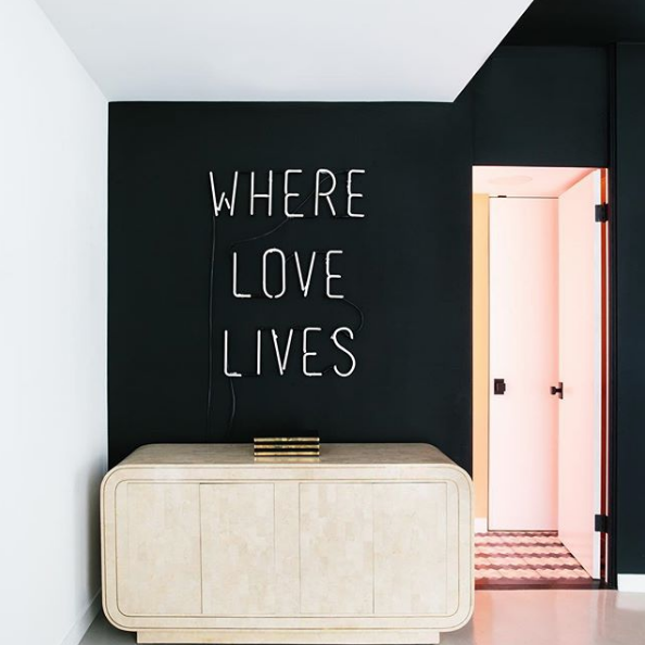 I love the contrast of the black wall, and the bright white neon sign. Design by the talented  Black Lacquer Design.