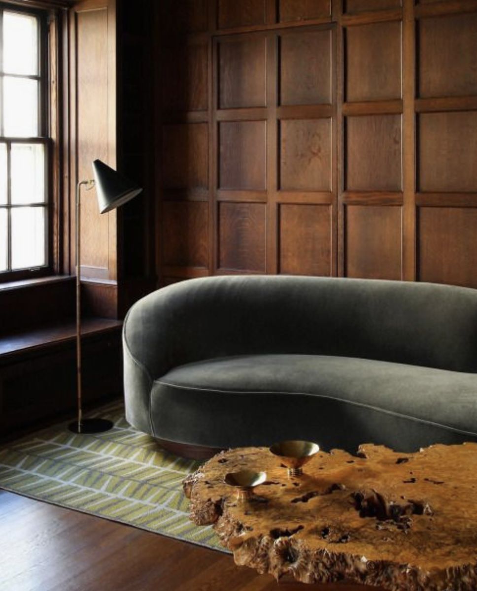 This burl wood coffee table adds so much organic texture to the room.