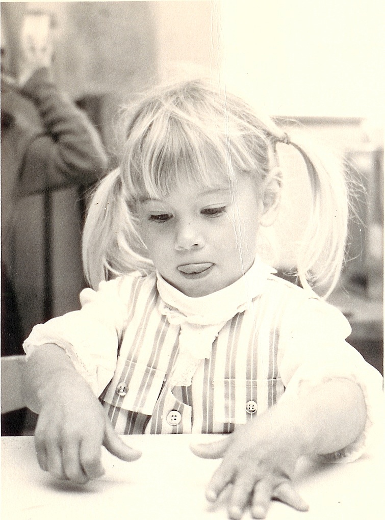 Me as a busy pre-schooler, creating a masterpiece. (You can tell I'm concentrating because my tongue is sticking out.)