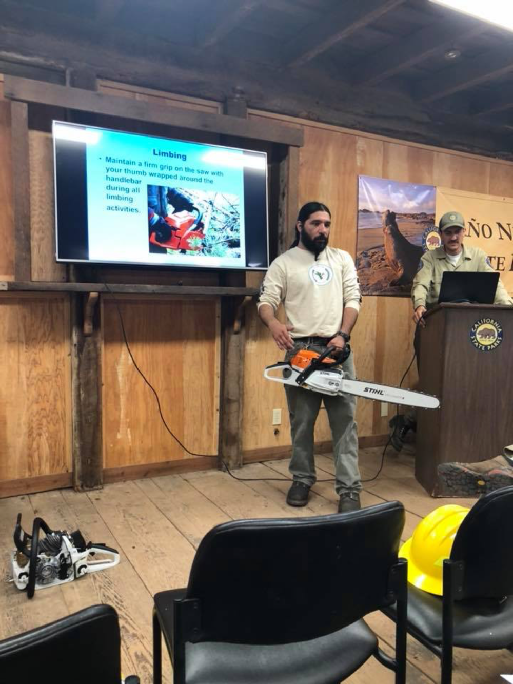 "NSC Deputy Director Abran Lopez, an experienced sawyer, trains ""green"" crew members along with California State Parks field staff. Photo courtesy Mariah Cuevas."