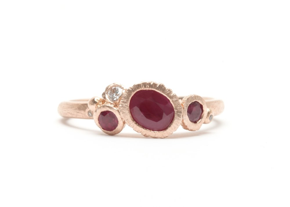 Custom Rocky Reef ring in 18 carat rose gold with clients own rubies, and white and champagne diamonds.