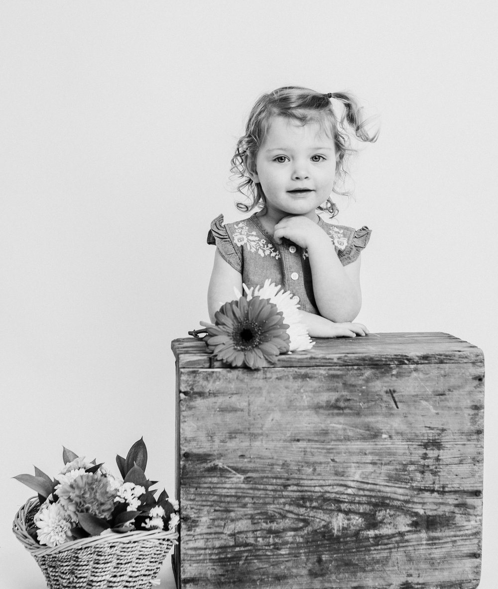 girl in studio with flowers  belleville family photographer