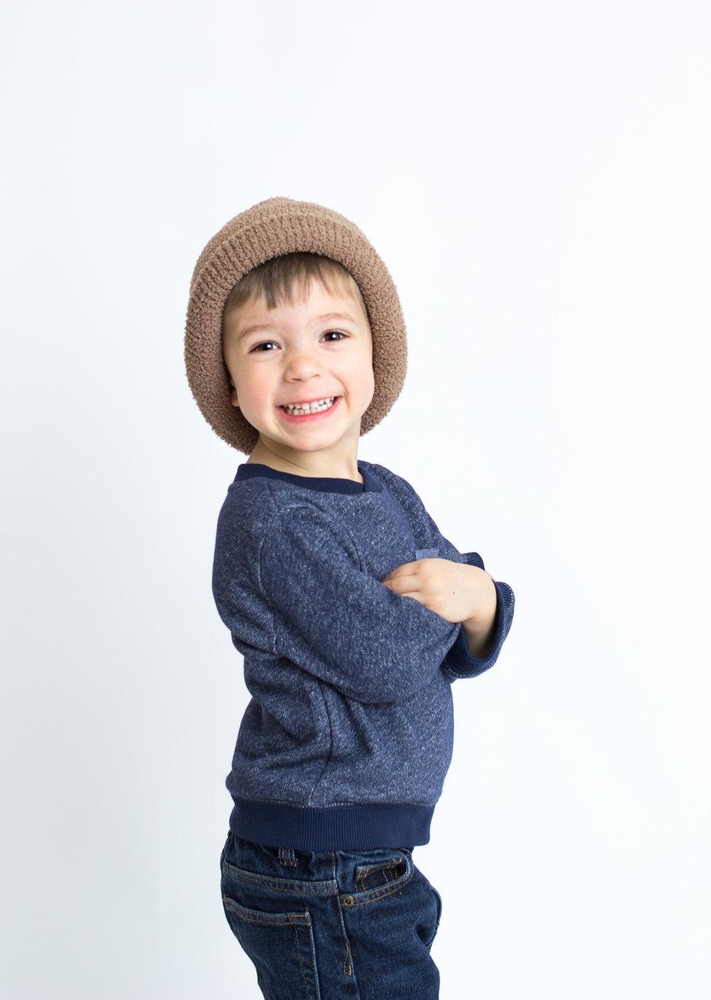 boy in studio smiling  belleville family photographer