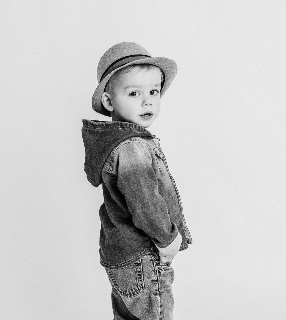 Boy looking over shoulder in studio  belleville family photographer