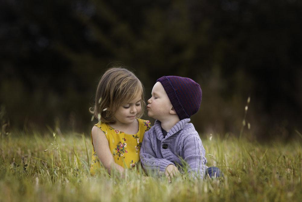 toddler girl and boy whispering  belleville family photographer