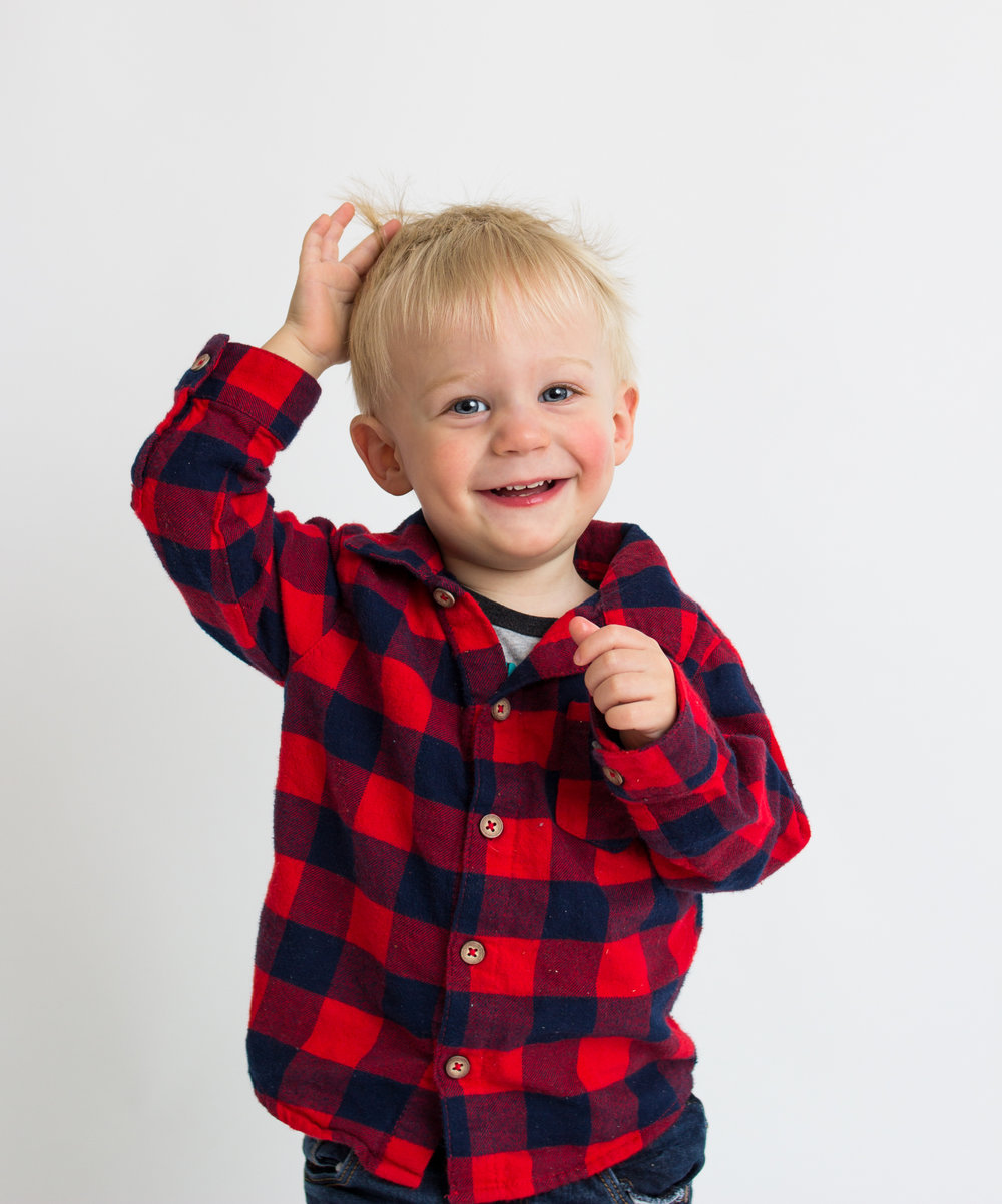 boy in plaid shirt in studio smiling  belleville family photographer