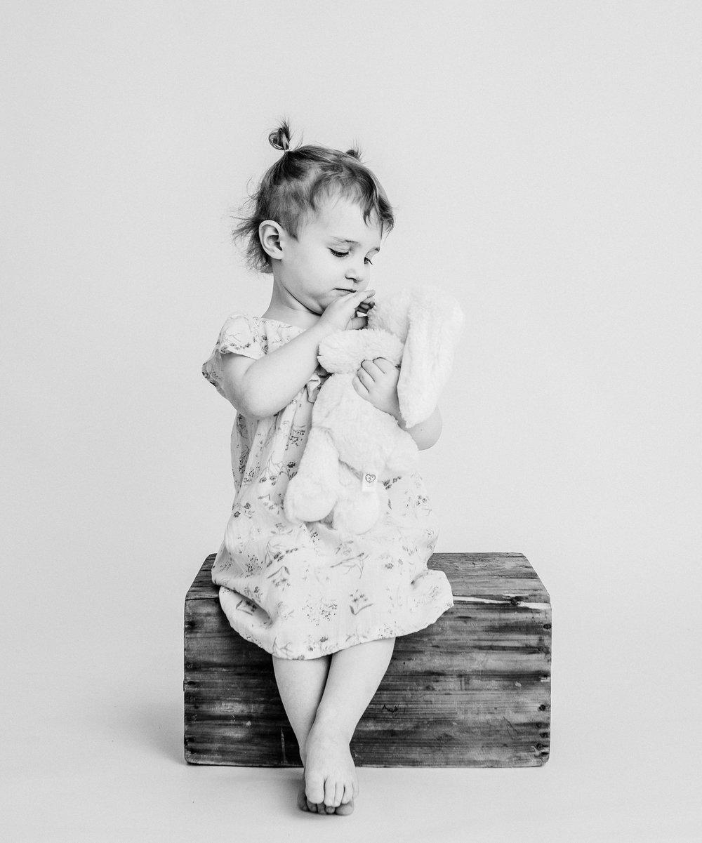 girl in studio cuddling bunny  belleville family photographer