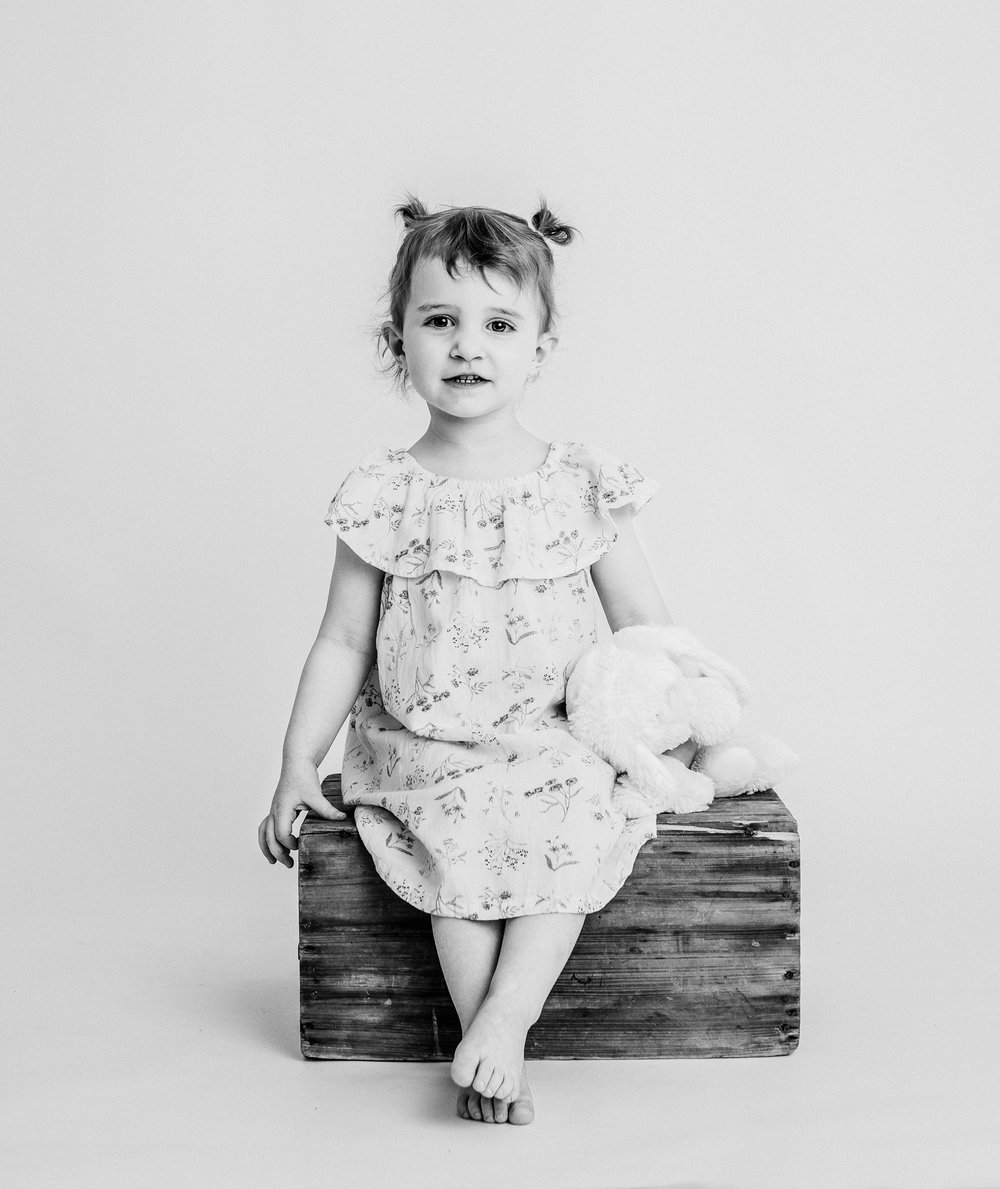 toddler girl in studio with bunny belleville family photographer