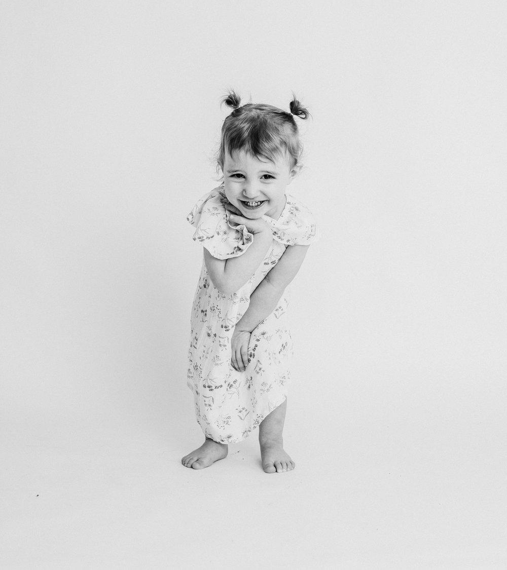 girl in studio laughing  belleville family photographer