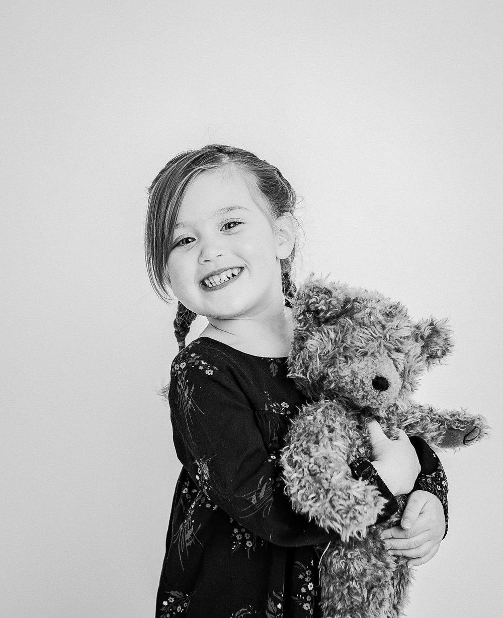 girl in studio with bear  belleville family photographer