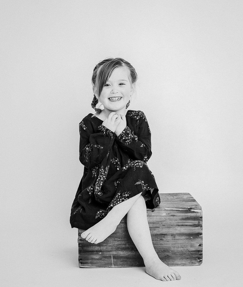girl in studio smiling  belleville family photographer