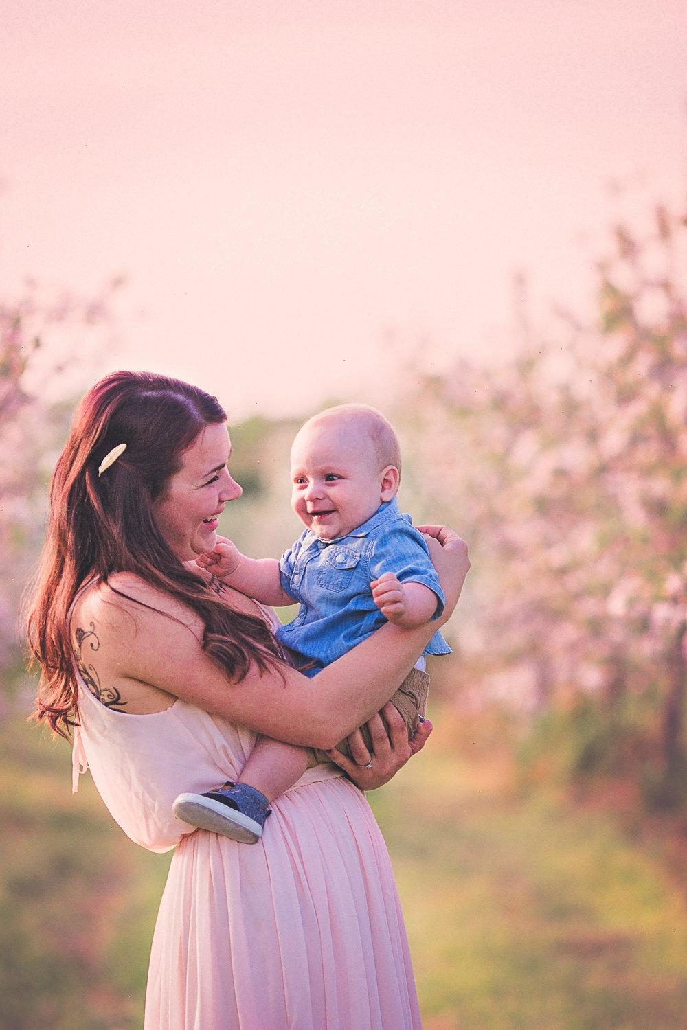 mom with baby in apple orchard  belleville family photographer