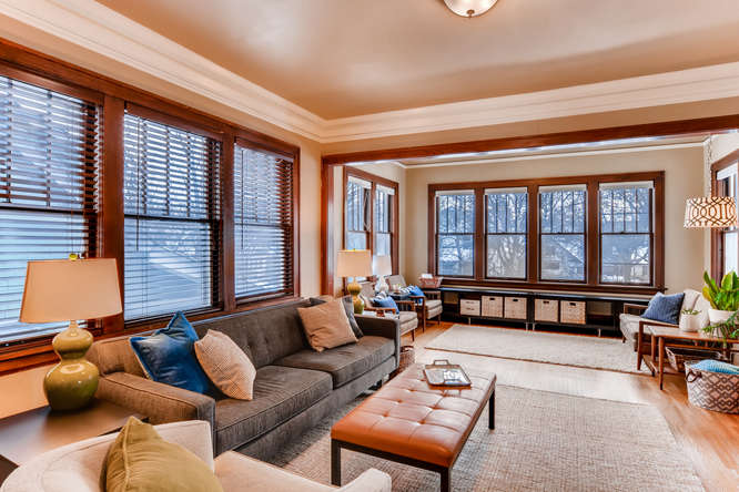 The living room is connected to the sunroom and dining room, giving us a large, open living area.