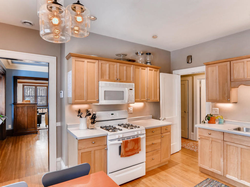 The kitchen is really good sized for a duplex - it's one of the reasons we fell in love with the building. The previous owner had installed the newer cabinetry. We put in a new range and microwave.