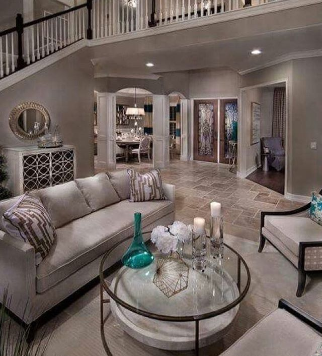 Neutral tones with a pop of accent color make the most beautiful interior designs. ✨ The openness of the upstairs catwalk keeps this living area bright and spacious. Stunning! ✨ ✨ ✨ ✨ ✨ ✨ ✨ 📸: cred unknown  #womeninrealestate #fempreneur #realestateinvesting #womeninspiringwomen #realestateinvestor #bossup #bosschick #femaleempowerment #homeowners #womenwholead #bossmom #shemeansbusiness #bossmoves #femaleceo #girlbosses #homeowner #femaleentrepreneurs  #womenwhohustle #femalebusinessowner #womensupportwomen #feminists #workingwoman #businesswoman #successfulwoman #passiveincome