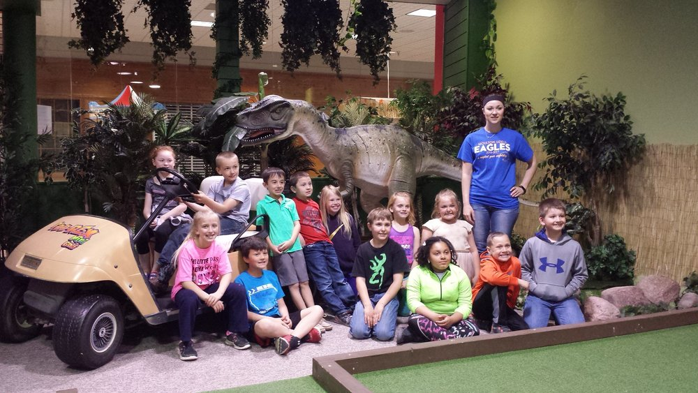 Take a selfie with a velociraptor at  Tee-Rex Indoor Mini Golf  - Iowa's only dinosaur themed family mini golf!