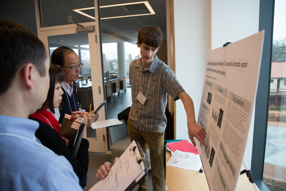 Owen explaining his results during the first round of judging. (Photo: Academy of Science-St. Louis)