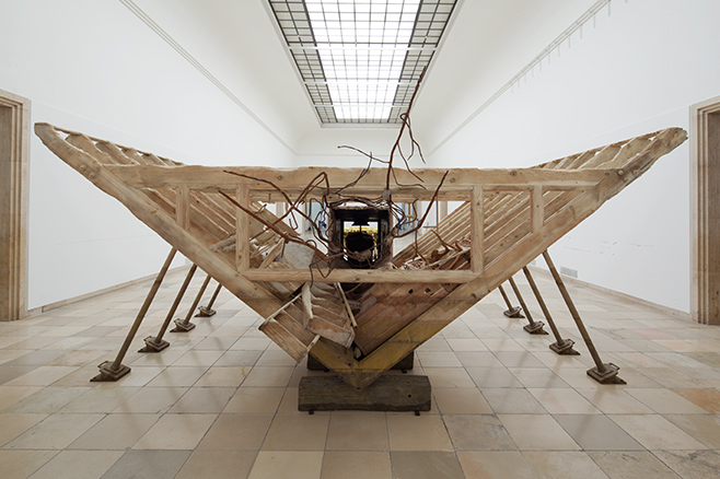 Matthew Barney, Boat of Ra, 2014, wood, cast bronze, resin-bonded sand, steel, and gold plating, 132 × 600 × 288 in., installation view of Matthew Barney: RIVER OF FUNDAMENT at Haus der Kunst, 2014, courtesy Laurenz Foundation, Schaulager, Basel, photo by Maximilian Geuter