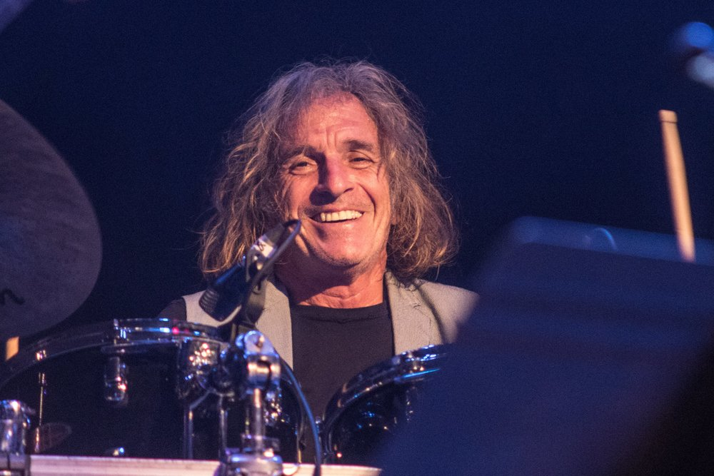 """CORKY    Corky Laing  is a drummer, songwriter, singer and a raconteur. He is best known as the drummer of the legendary bands   Mountain   (1969-) and   West, Bruce & Laing   (1973-75).   Mountain   toured and recorded on and off until 2010. In the late 70s  Corky  released his solo album """" Making it on the Streets """" that is often cited as an overlooked pioneer of AOR. In the early eighties Corky recorded with an indie band called   the Mix   and at the end of 1990s he got together with  Noel Redding  (  Jimi Hendrix's Experience  ) and  Eric Schenkman  (  Spin Doctors  ) to form the band   Cork  .    In the 90s  Corky  worked for several years as the vice president, A&R, of  Polygram Records ,  Canada . During that time, he produced bands like   Men Without Hats   and   Bootsauce  . He also had his own radio show,  Under the Rock , in  Canada , has published an anecdotal road stories –book,  Stick it!  and has his one-man show,  The Best Seat in the House , a humorous autobiographical production that combines storytelling and music.    In the early part of 2010s  Corky  was busy with  Playing God: The Rock Opera  – a critically acclaimed collaboration with two Finnish philosophers. In 2014, he was awarded with the  Bonzo Bash Legends Award  (following Bill Ward, Carmine Appice and Peter Criss).    Since 2015 Corky has been touring the world with   Corky Laing's Mountain   – celebrating the Mountain legacy. He has also been writing new material with his current live band and the album,  The Toledo Sessions  will be released in May 2019 by Prudential Records. His autobiography, written together with  Tuija Takala ,  Letters to Sarah  is published by Polite Bystander Productions in April 2019."""