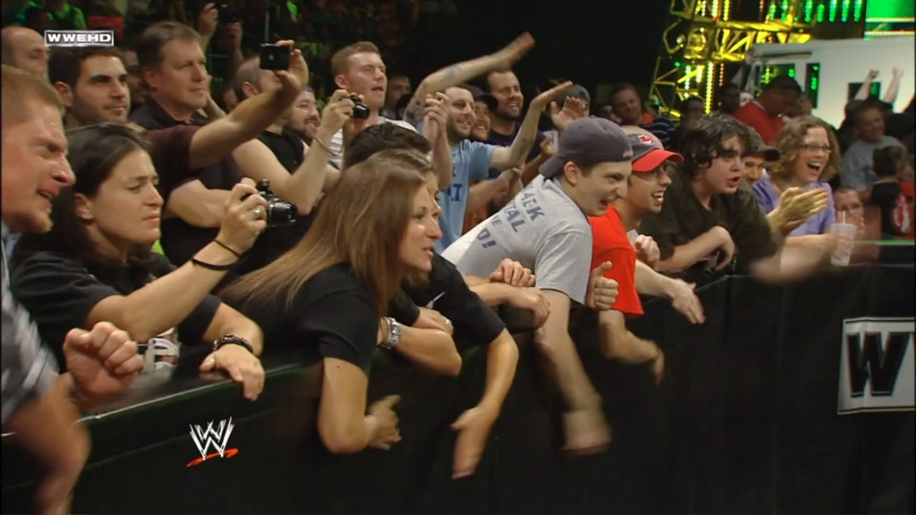 The crowd begging for Cena to tap out (Screencap)