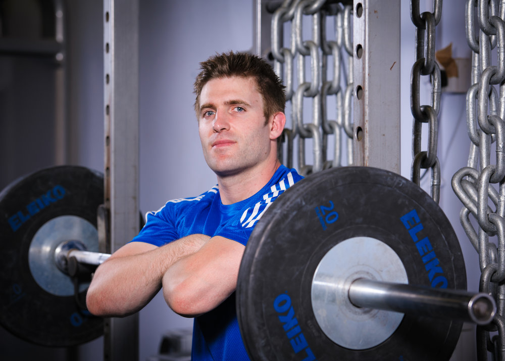 Environmental portrait taken of a strength and conditioning coach at Leeds Met Gym