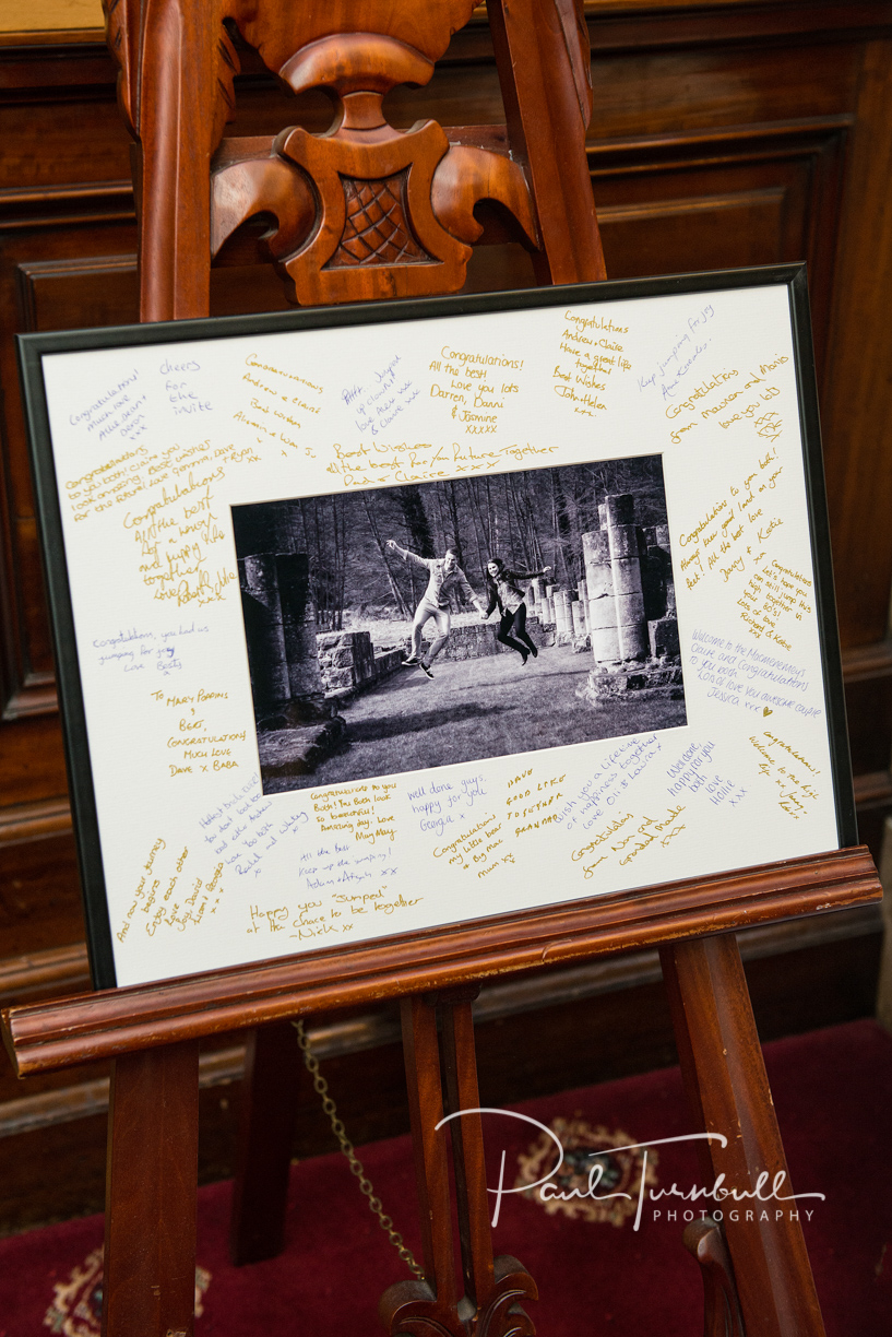 Pre-wedding photo displayed in a framed signature mount