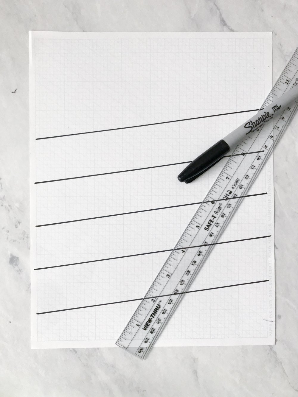STEP 2:TRACE YOUR LINES - Trace over your lines with black marker to make them easier to see underneath of your marker paper when you begin your writing.