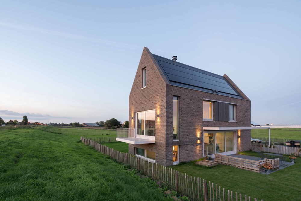 """not a box in an empty field""   contemporary variation on the classic Dutch dike house"