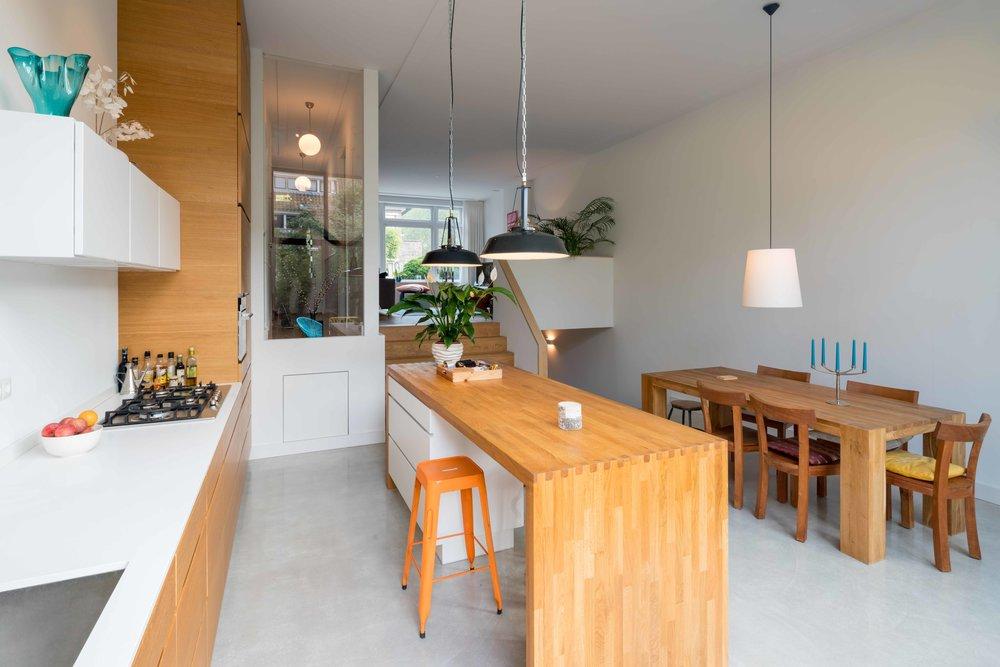 contrast between the wooden elements and concrete floor