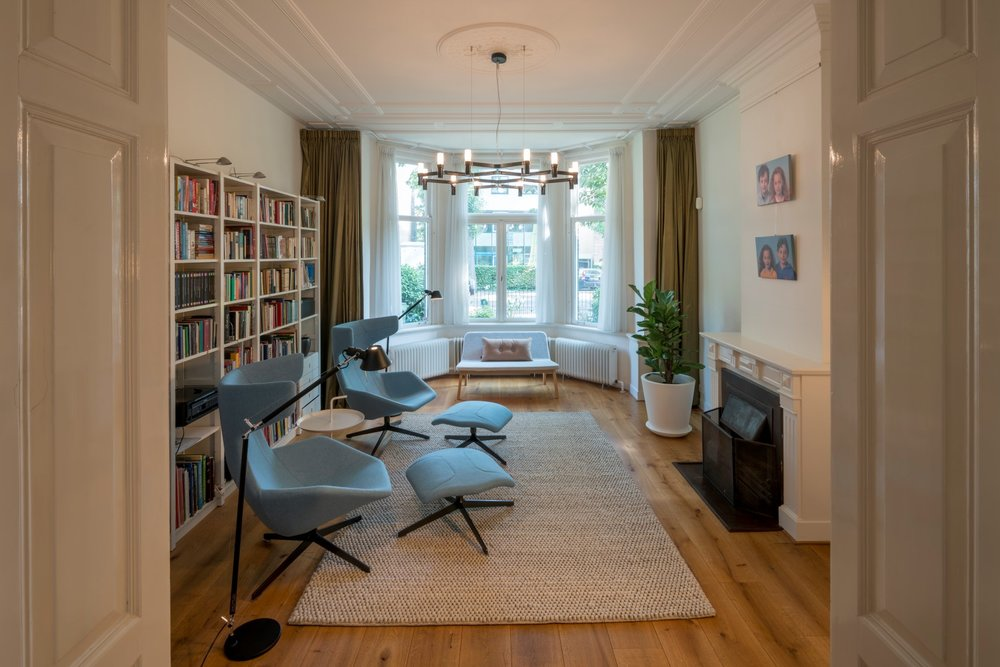 formal front room serving as a library