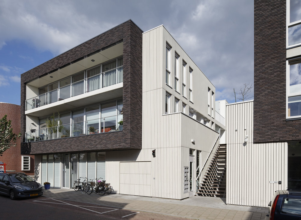 two cantilevered brick volumes are placed   on top of this ground floor