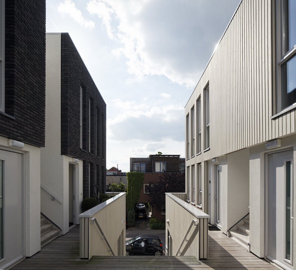Wide balconies and gallery spaces provide a place for neighbors to make small talk and greet each other