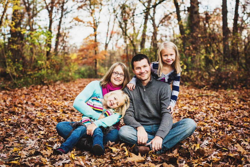 peoria family portrait in fall leaves