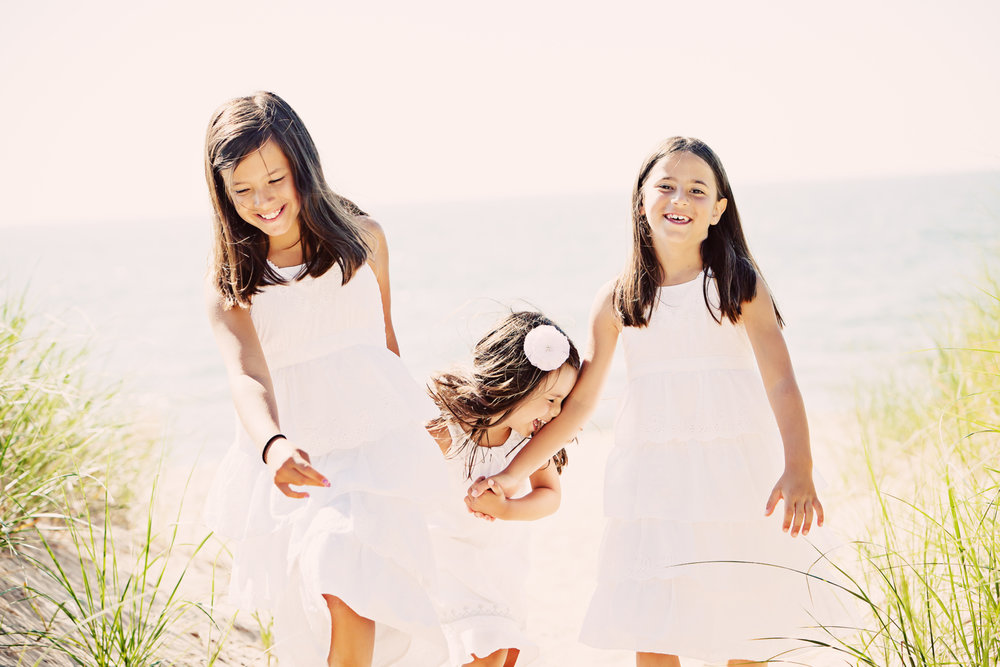 sisters wearing white at beach