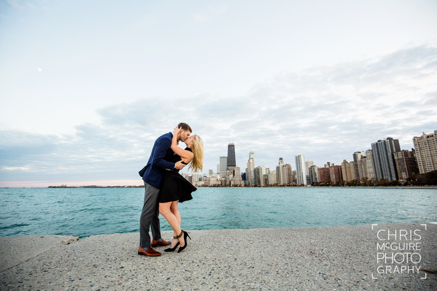 chicago skyline engagement couple kissing