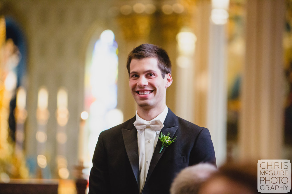 groom as he sees bride in aisle