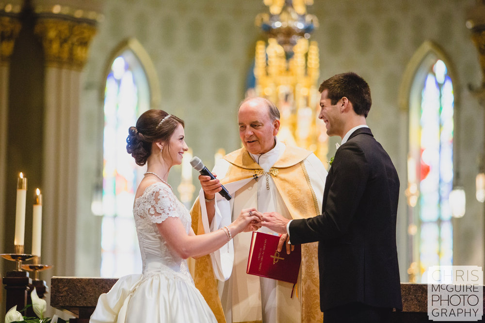 bride groom exchanging vows at notre dame basilica