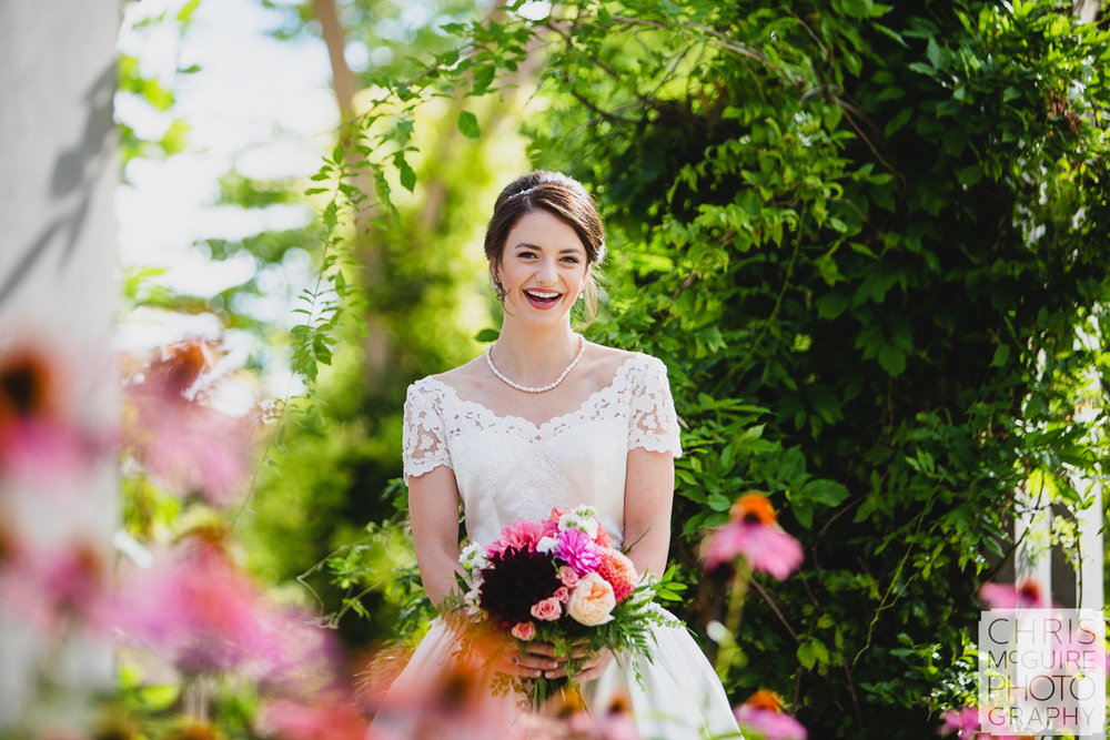 bride in garden with pink flowers