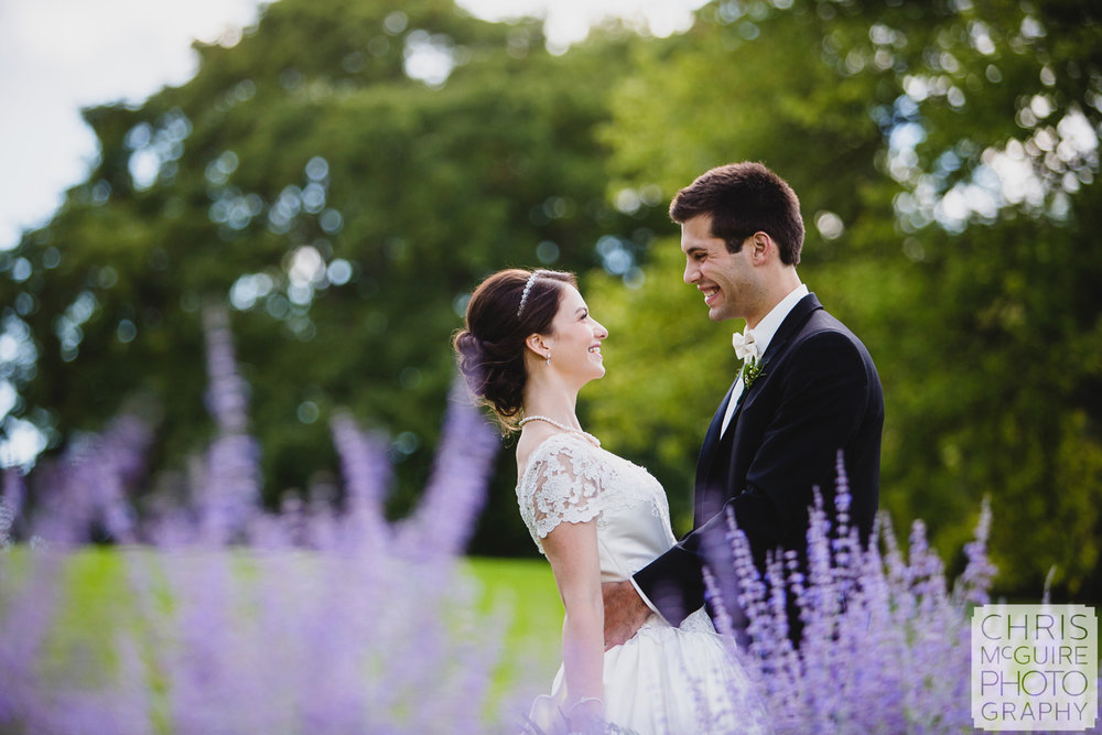 wedding couple with purple flowers