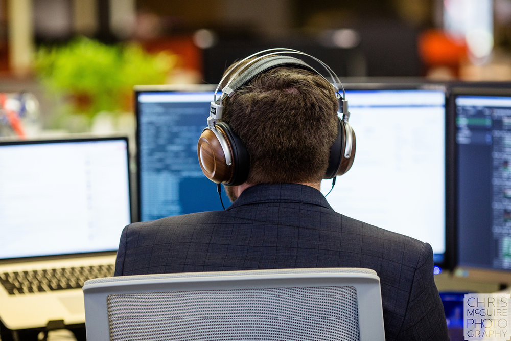 man wearing headphones at computer
