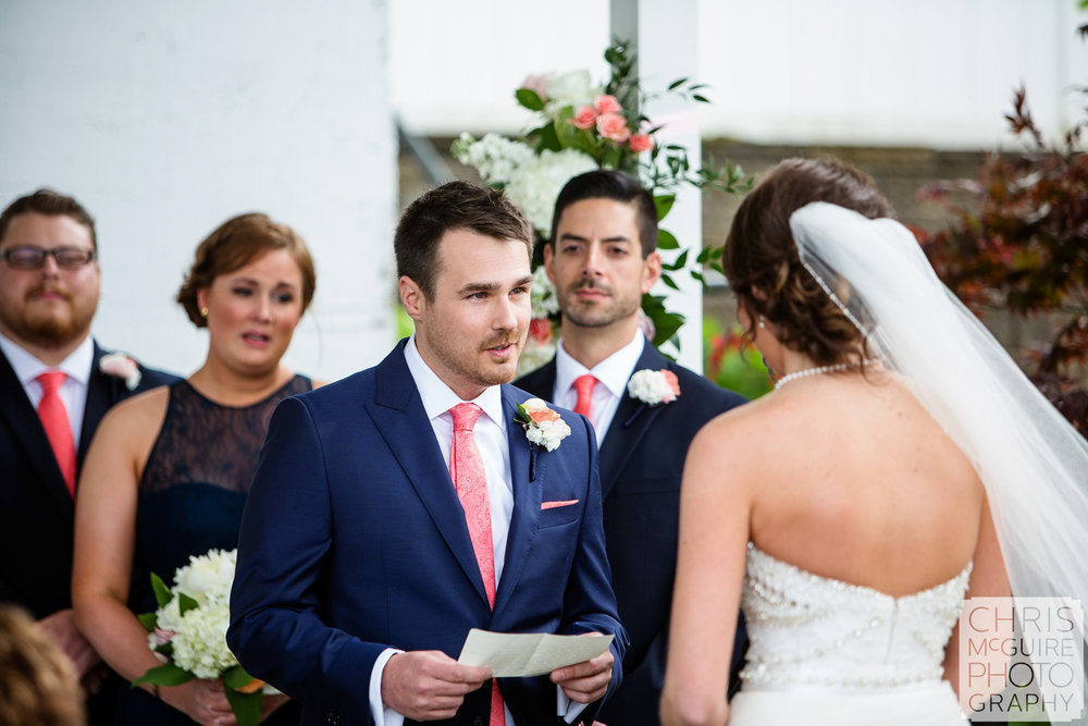 groom reads vows to bride