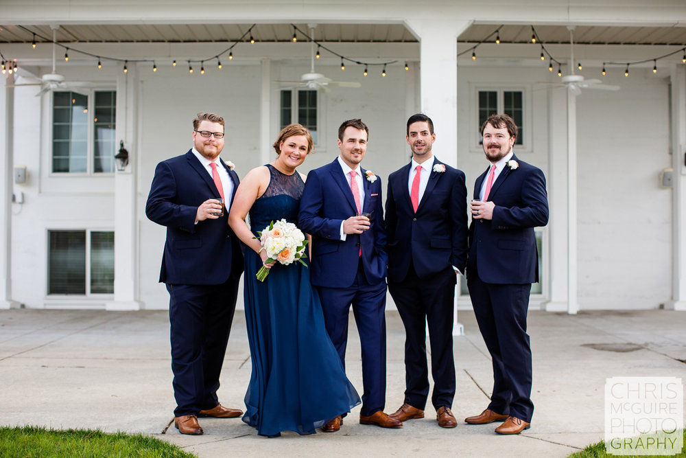 groom with wedding party and drinks