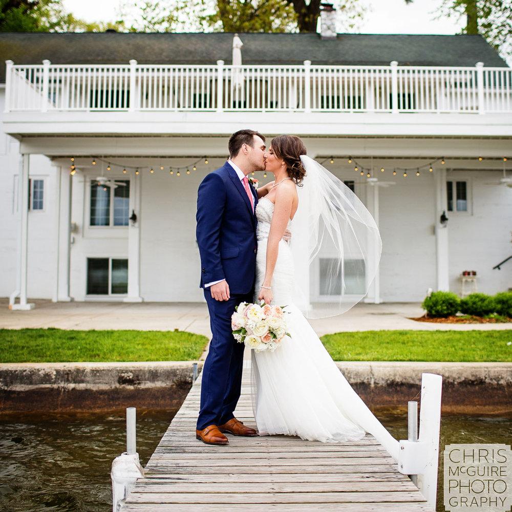 bride groom kiss veil flying