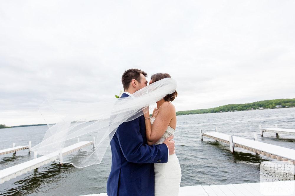 bride groom kiss at lake