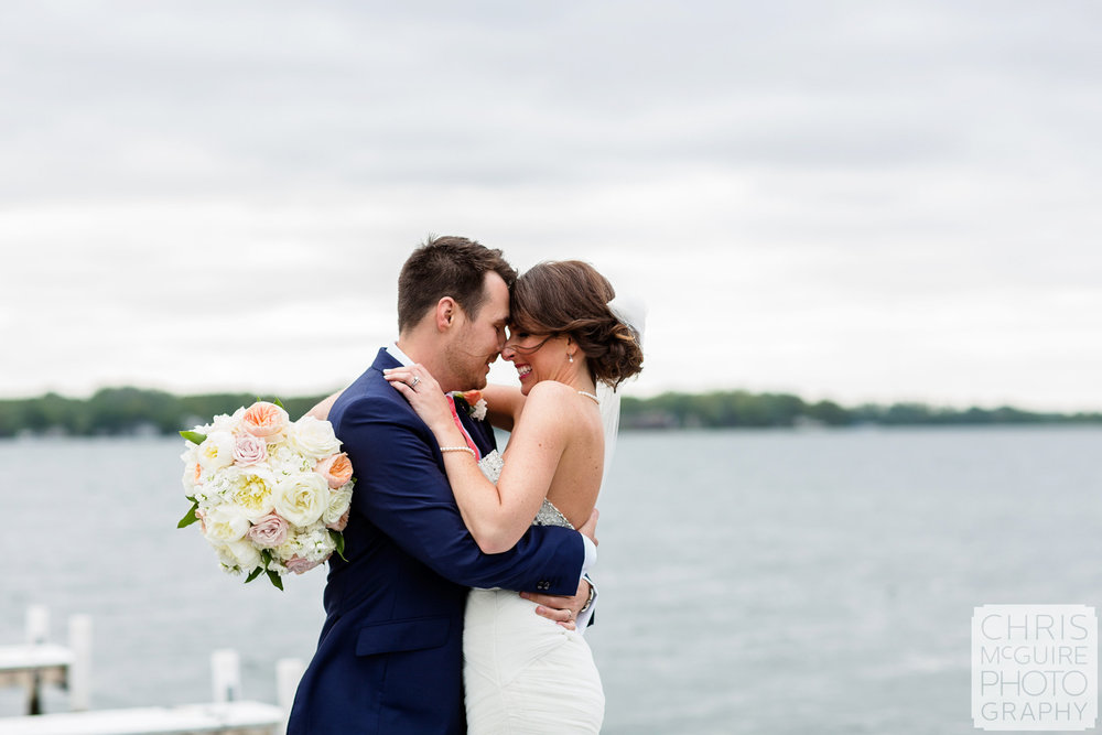 couple by lake at wedding
