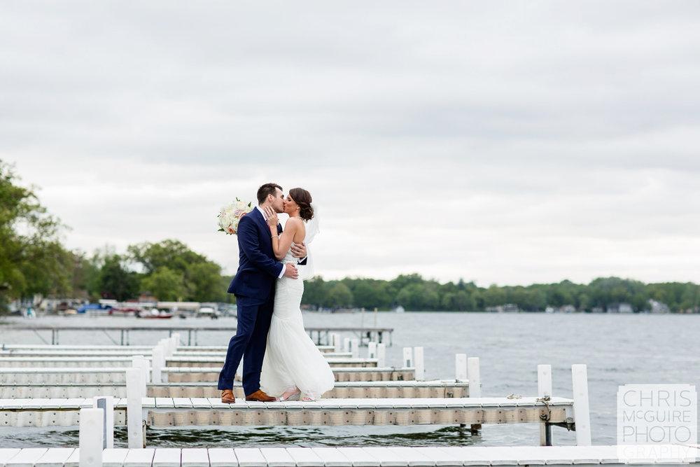 wedding kiss on dock by lake