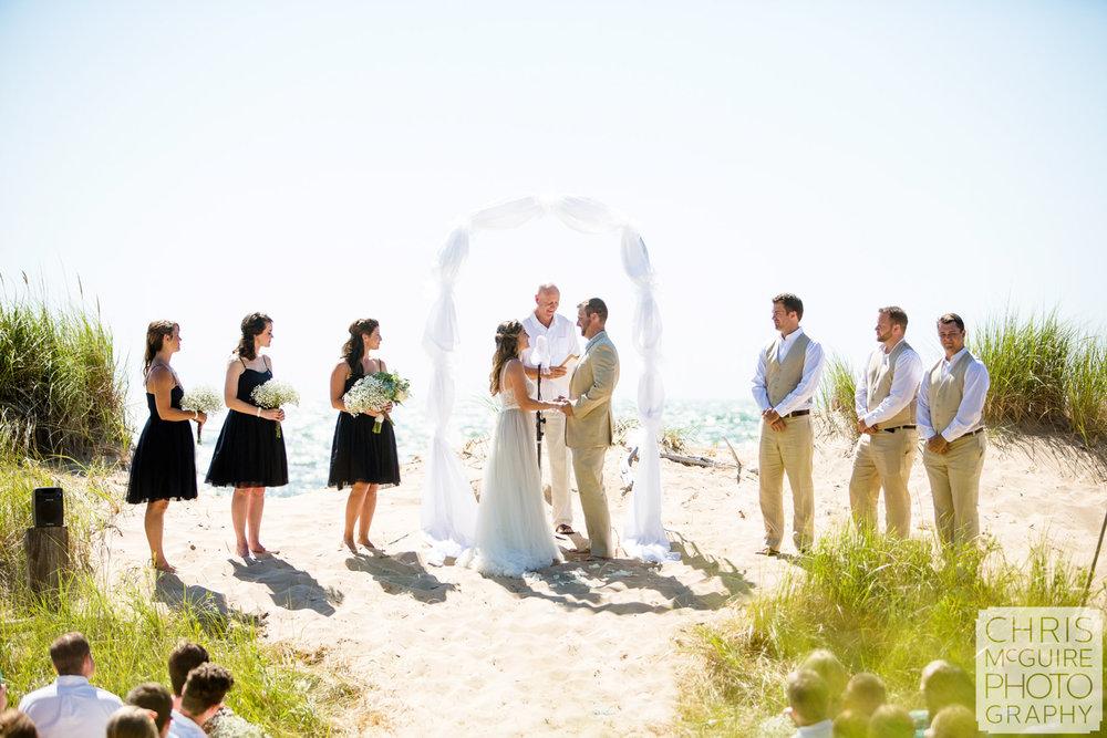 wedding party standing at beach wedding lake michigan