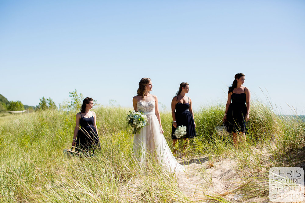 bride and bridesmaids in beach grass