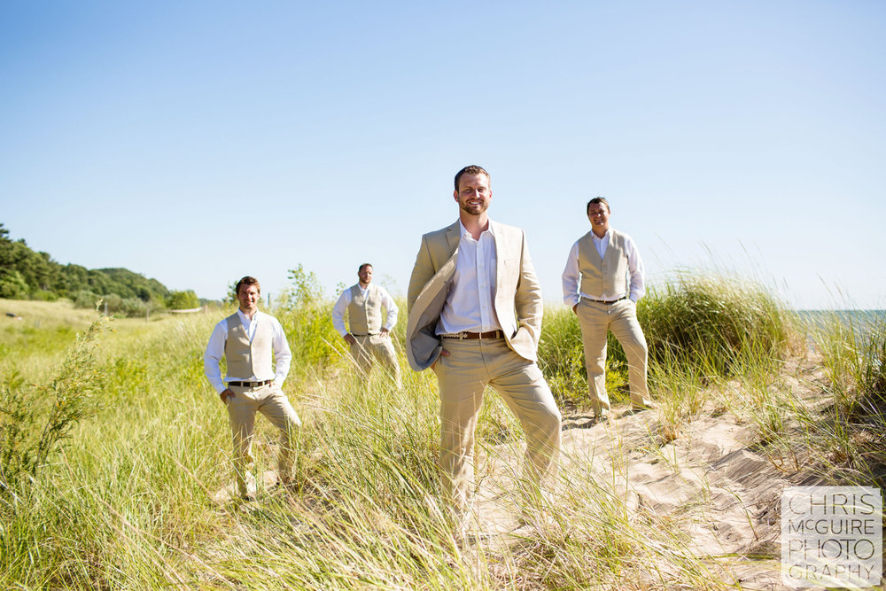 groom and groomsmen in beach grass