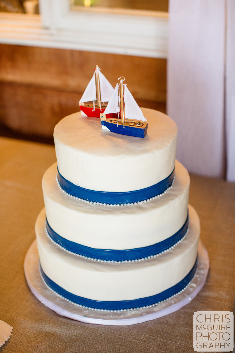 wedding cake with sailboat topper